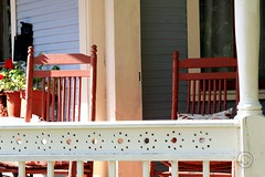 IMG_4542 (Ron_3) Tags: frontporch rockingchairs red flowers landscape