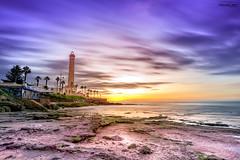 Playa de las Canteras Chipiona (manuelcastro85) Tags: chipiona cadiz andalucia playa canteras sea beach sun atardecer landscape rocas lighthouse faro clouds