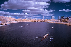 Head of the Charles Regatta (Jon Bush) Tags: city bridge blue autumn sky white fall water colors sunshine boston clouds race river ir golden fuji exercise charlesriver sunny wideangle row autumncolors crew infrared rowing fujifilm regatta amateur headofthecharles fallclassic xe1 lifepixel