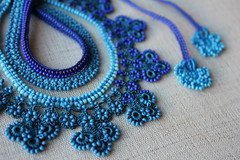 Beaded crochet statement necklace with cobalt blue and turquoise blue seed beads and crocheted flowers by irregularexpressions (irregular expressions) Tags: necklace jewelry beaded tiffanyblue sapphireblue seedbeads beadednecklace indigoblue beadcrochet freeformcrochet delicabeads turquoiseblue crochetnecklace beadedcrochet lacenecklace beadedlace irregularexpressions statementnecklace fibernecklace beadworknecklace statementjewelry royalbluenecklace freeformcrochetnecklace tealbluenecklace cobaltbluenecklace beadedcrochetnecklace