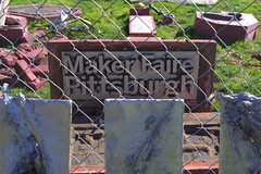 Custom Maker Faire Pittsburgh sign cast in aluminum live at the Faire by Kilowatt Gallery.