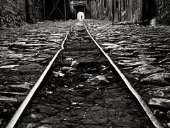 Man at the end of the tunnel (Tilemachos Papadopoulos) Tags: blackandwhite bw black monochrome dark mono vanishingpoint qoq m43 mft mirrorless
