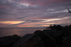 Bellport, NY (Vicki from Yaphank) Tags: sunset sun ny beach bay rocks peace bluesky longisland serene pinksky sunchaser