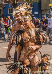 Notting Hill   TrinDiego (TrinDiego) Tags: carnival nottinghill costume street party festival parade london 2016 beauty beautiful catchy colour streetphotography catchcolours uk performer bright orange lady wings nottinghillcarnival