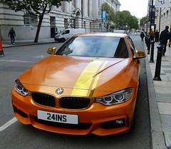 He wishes! (helenoftheways) Tags: 21inscarreg cars bmw orange bollards pavement londonse1 uk freeassociation