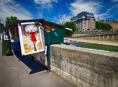 Art in Paris, France (` Toshio ') Tags: toshio paris france seine river art europe european europeanunion riverbank umbrella sky clouds fujixe2 xe2 boat architecture building reddress