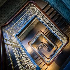 Diagonal stairs (uneitzel) Tags: abwrts architecture architektur bannister diagonal downwards gelnder hamburg holstenhof jugendstil kachel kontorhaus mzuiko918mm olympusem5 spiral spirale square staircase stairs tiles treppe treppenhaus