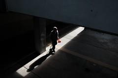 Walking Through (Wilson Au | ) Tags:   hongkong kwuntong fujifilmxe2 xf1855mmf284rlmois fujinon light contrast backlight geometric shadow silhouette