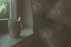Stay inside (Moesko Photography) Tags: analogue smena8m coffee mug window curtain pillow home indoor morning shadow still ambient salzburg austria