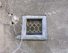 stained glass window in wooden frame in stucco wall (Kathejo B) Tags: france stainedglass aveyron rodez woodenframe diamondpattern kathejo