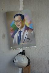 the king and a helmet (the foreign photographer - ) Tags: king portrait helmet wall hanging bangkhen bangkok thailand nikon d3200