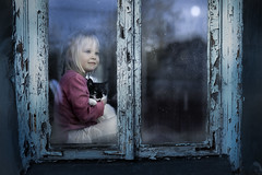 Agata and the cat (iwona_podlasinska) Tags: girl cat window winter cold mood night moon child animal pet home
