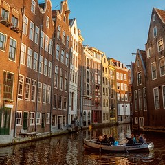 Exploring canals (spiridono) Tags: people trip canal water amsterdam netherlands boat architecture europe tourists sun sunset golden hour autumn warm light