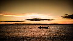 Pescadores al atardecer (Seewald Gabriel) Tags: corrientes costanera rio parana atardecer cielo contraluz river bridge sunset playa beach pescadores canoa boat