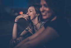 Waiting - Jason Bihler Photography (Jason Bihler Photography) Tags: color outdoor tn nashville state girl girls portrait depthoffield fair tattoo smile angles wristband event street streetphotography contemplation hand canon 5dmarkiii 50mm candid