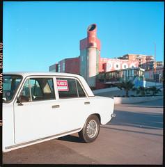 (Stuck Outside a Fiat 124 With The Pinetamare Blues Back Again) (Robbie McIntosh) Tags: rolleiflex rolleiflex28e rolleiflex28e2 rolleiflexplanar28e carlzeissplanar80mmf28 tlr 120 mediumformat 6x6 square negative film filmisnotdead moyenformat mittelformat medioformato pellicola selfdevelopment dyi homedevelopment kodak kodakektar100 ektar newtopographics newtopography c41 color bellinifoto bellinic41 bellini decay landscape car classiccar pinetamare villaggiocoppola fiat124 vendesi
