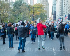 Anti-Trump Protesters march on Central Park South, New York City (jag9889) Tags: jag9889 president signboard demonstration manhattan banner people 20161113 outdoor donaldtrump centralparksouth immigrants newyork text motorcycle rally march midtown immigration newyorkcity 59thstreet elect usa sign trump 2016 protester ny nyc unitedstates unitedstatesofamerica us
