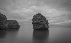 Resting (Robgreen13) Tags: uk devon ladrambay seascape coastal seastack longexposure cliffs clouds rocks bw mono