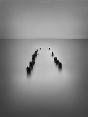 Remains (Alex Apostolopoulos) Tags: blackandwhite longexposure monochrome fineart poles seascape smooth cyprus sony sonya6000 ilce6000 haida sigmae60mmf28dnart sigma ndfilter manfrottobefree