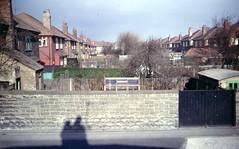 img230 (foundin_a_attic) Tags: april 1973 street houses homes fashion eveyday life england suburbs garden wall chimney green house