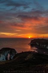Sunrise On The Coast (cdhardaker) Tags: sunrise clouds photography england sky jurassiccoast movement seaside sea cliffs calm ocean water blue reflections rocks fire landscape lighthouse bridlington flamborough horizon