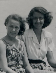 1942. Mum and a friend (elinor04 thanks for 18,000,000+ views!) Tags: family summer woman man beach weather fashion vintage photo hungary wind young style windy sunny siblings 1940s 1942 hairstyle sunbathing tanned balatonfred elinorsvintagephotocollection sunbathingsuits