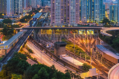 Kowloon Bay, Hong Kong (mikemikecat) Tags: building bus ferry shopping hongkong bay pier twilight estate nightscape sony centre cityscapes depot lighttrails nightview choi  kowloon  tak terminus   carlzeiss kowloonbay kbd  a7r     sel2470z fe2470mm mikemikecat
