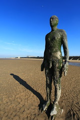 Stood still (Barry Miller _ Bazz) Tags: blue shadow england sky sculpture man art beach water canon lens landscape seaside sand open air l mk2 17 5d 40 usm ef crosby merseyside f4l