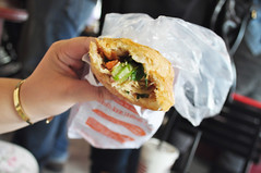 Breakfast on the move (Roving I) Tags: food vietnam wrappers hcmc banhmi hochiminh breadrolls vietnamesecuisine huynhhoa