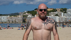 Beach portrait. (CWhatPhotos) Tags: cwhatphotos beach coast evening light sun going down camera photographs photograph pics pictures pic picture image images foto fotos photography artistic that have which contain olympus majorca santa ponsa hotels spain holiday cloudy day hot sand water portrait face pose poser onthe man tatts tattoo tattooed tattoos inked tribal shoulder shoulders blue mallorca mediterranean balearics smile smiles balearic islands island flickr