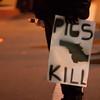 Protestor Holds Bottle, Oakland Riots (Thomas Hawk) Tags: california usa oakland unitedstates unitedstatesofamerica protest bart eastbay downtownoakland fav10 bartpolice oscargrant oaklandriot oaklandriot2009 oaklandriots2009 oscargrantriots oaklandriots
