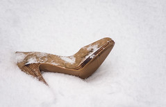 High Heel Left Behind in the Snow (Orbmiser) Tags: morning winter snow cold oregon portland nikon highheel ground snowing sho d90 55200vr