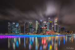 Dramatic clouds (leslie hui) Tags: marinabay centralbusinessdistrict fullertonbayhotel architecture fullerton nightscape singaporefinancialdistrict singapore cityscape cbd city night