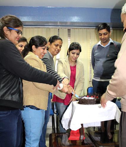 LinguaSoft EduTech Chandigarh Team cutting the Cake at New Year Eve