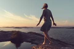 Moments (ErlandG) Tags: clouds island ocean sea september sky sunset walking windy woman