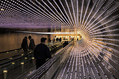 """Multiverse"" LED art installation at the National Gallery of Art, Washington, DC (dckellyphoto) Tags: leovillareal multiverse lights led leds blinking flashing concourse nationalgalleryofart nga underground walkway contemporaryart modernart tunnel walk movingwalkway installation light spots metal art artwork subterranean people dark backlit round"