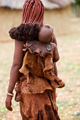 Himba baby carried by woman, Kaokoland, Namibia (Alex_Saurel) Tags: bebe outdoor female cute hair tribu portrait longhair nomadicculture portray africa indigene ethnie people femme beautiful africans ethnique headshot photojournalism portraiture traditional tribe color estethique afrique afriqueaustrale shavedhead shaved baby ethnic nomadicherder tradition beaute nomadicherderculture nomad culture indigenous woman lifestyles southernafrica african day tribal nomadic 85mmf14za