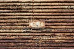 Rusty roller shutter (Jan van der Wolf) Tags: map162461v rusty rust roest roestig rollershutter decay rolluik monochrome monochroom minimalism minimalistic minimalisme minimal sleutelgat keyhole