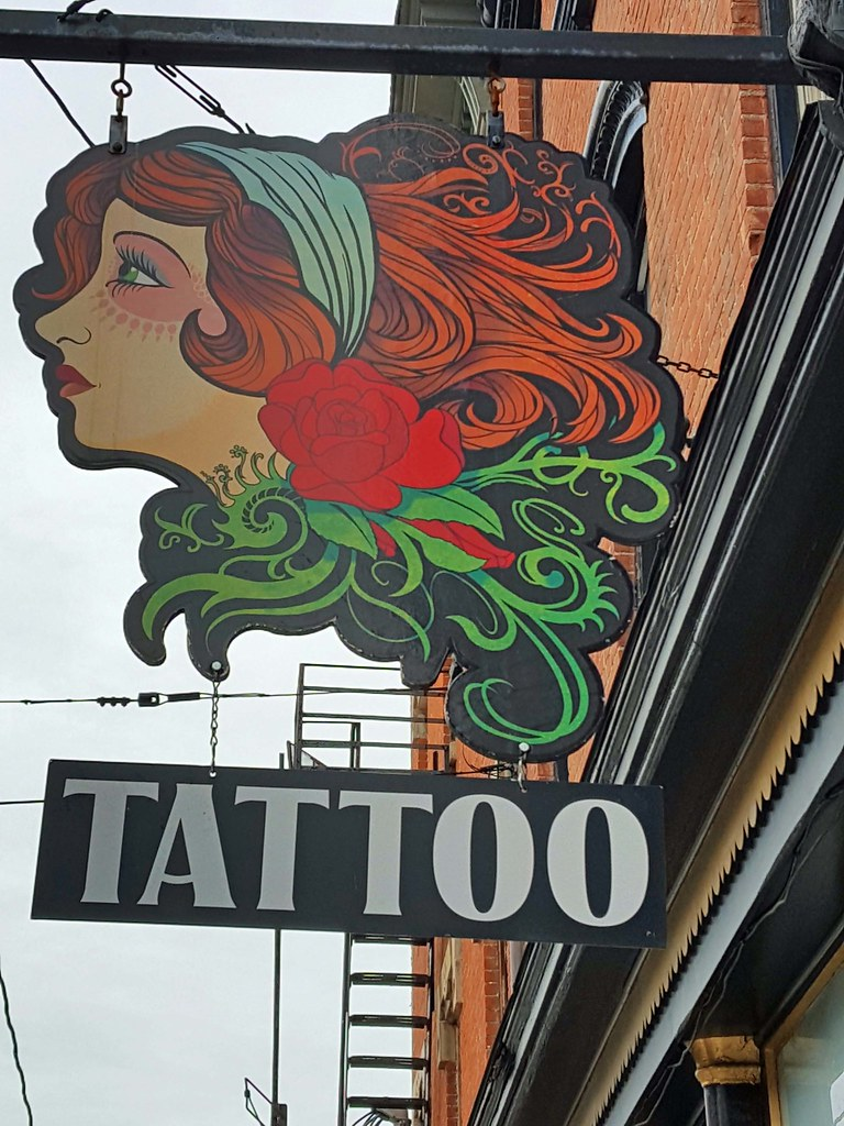 The world 39 s best photos of falls and signs flickr hive mind for Tattoo parlors wichita ks