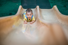 Portrait of baby boy playing in the Children's playground (HIKARU Pan) Tags: 1dx 50l asia canonef50mmf12lusm china eos1dx photography portrait shanghai babyboy cute horizontal lovely outdoors youngwoman