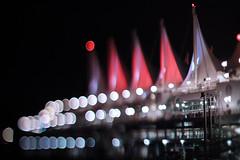 Canada Place (Jovan Jimenez) Tags: canada vancouver bc place eosm3 eos m3 canon 50mm nikkor nikon f12 tiltshift bokeh balls city red white sail sails boat night