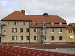 Harz_e-m10_100B067917 (Torben*) Tags: rawtherapee olympusomdem10 olympusm25mmf18 wernigerode harz fassade facade wendeltreppe spiralstairs sportsground sportplatz