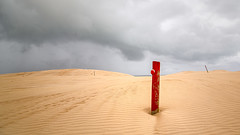 Red post (RWYoung Images) Tags: rwyoung canon 5d3 coffinbay southaustralia sand post red marker sky cloud rain