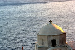 A monochrome church dome - a rarity (Nagarjun) Tags: blue sunset sun white church island volcano evening europe glow santorini caldera oia cyclades mediterranian firostefani aegeansea