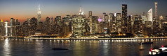 Manhattan Lights (michaelelliottnyc) Tags: nyc newyorkcity manhattan newyork pano bluehour urban metropolis gotham buildings lights nightlights river eastriver reflections colors sunset boats longexposure slowshutter