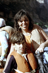 34-589 (ndpa / s. lundeen, archivist) Tags: nick dewolf nickdewolf color photographbynickdewolf 1970s 1973 film 35mm 34 reel34 arizona northernarizona southwesternunitedstates grandcanyon coloradoriver raftingtrip raftingexpedition water river raft inflatable people sanderson sandersonriverexpeditions srig lifejacket lifepreserver floatationdevice woman child son maggie quentin motherandchild motherandson watersedge riversedge riverbank 1972 sandersonraftingexpeditions
