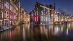Dutch Venice (Muhammad Syaiful Anam) Tags: amsterdam behindthelenscap canal city cityscape houses michielbuijse netherlands night nightphotography redlight water