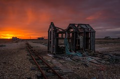 Dungeness Sunset (James Waghorn) Tags: sigma1020f456 autumn beach net dungeness pebbles railway sunset kent d7100 clouds desolate alone vibrant fishermanshut hut derelict abandoned england