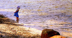 In a WORLD of her OWN...... (Lani Elliott) Tags: beach sand water child enjoyment excitement joy beautiful serene rocks pebbles colour color colourful