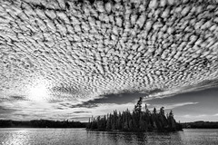 It's cloud illusions I recall ... I really don't know clouds at all (Canadapt) Tags: lake sunset clouds island pattern keefer canadapt bw